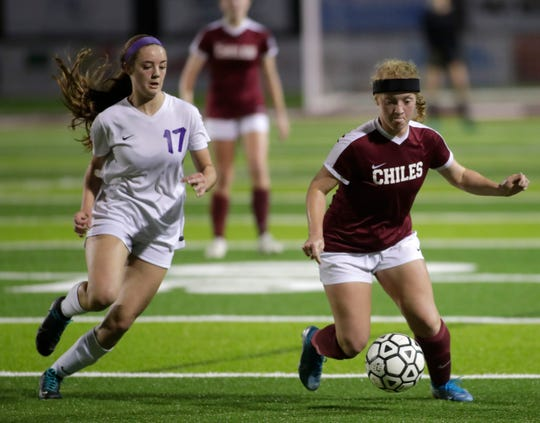 Chiles senior Margaret Harris dribbles with the ball as Chiles' girls soccer team advanced from a Region 1-6A quarterfinal playoff game following a 5-4 penalty-kick shootout win against Jacksonville Fletcher on Tuesday, Feb. 11, 2020.