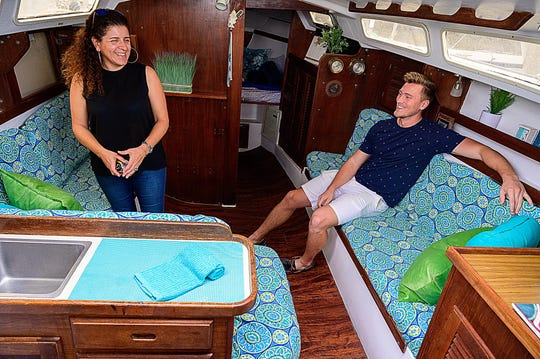 Dream Aboard Boatels owners Sofia Silva and Andrew Frisch talk on Thursday, Feb. 6, 2020 in the cabin of a sailboat that their company offers as a vacation rental in the English Landing Marina in St. Augustine.