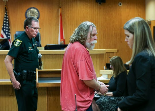 Chester Price (middle), 49, was at the Martin County Courthouse Wednesday, Feb. 12, 2020, in Stuart, to sign an agreement with the state to be voluntarily held in civil custody to receive treatment as a sexual predator under Florida's Jimmy Ryce Act. Price was convicted in 2014 for the 1993 death of Andrea Parsons, a 10-year-old Port Salerno girl.