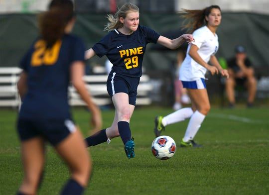 Maddie Nield (29), of the Pine School drives the ball upfield during the seconbd half against the Geneva School during the Girls Soccer Region 2-2A Quarterfinals, Pine School vs. Geneva, at the Pine School on Tuesday, Feb. 11, 2020, in Hobe Sound. Geneva won 4-0 over Pine School.