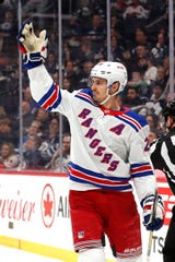 Feb 11, 2020; Winnipeg, Manitoba, CAN; New York Rangers left wing Chris Kreider (20) celebrates his first period goal against the Winnipeg Jets at Bell MTS Place.