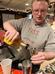 Timothy Bruck, Jr.  participates in a bartending class at SUNY Ulster.