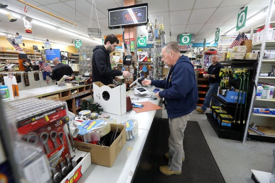 Longtime customer Jim Micinowski of Stony Point makes a purchase at Homestead Hardware Feb. 12, 2020 in Stony Point. The hardware store is closing after 50 years in business.