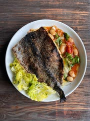 Catskill Trout with escarole and tomato braised butter beans from Harper's in Dobbs Ferry.