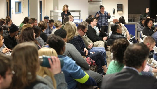 Odyssey Charter School community members listen during a town hall-style meeting including several board members in the wake of the school being again placed under state review and controversial comments by a board member.