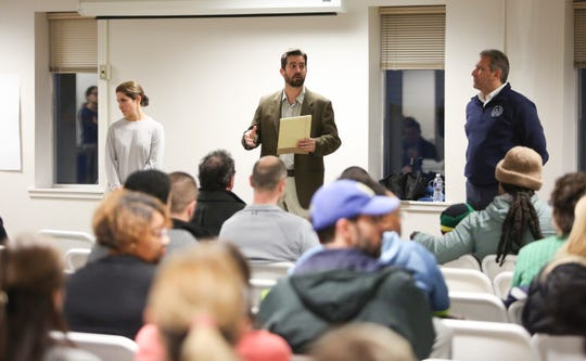 Odyssey Charter School board members (from left) Alisa Moen, president Josiah Wolcott and Elias Rigas take part in a town hall-style meeting in the wake of the school being again placed under state review and controversial comments by a board member.