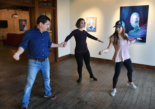James and Stacie Cook work with their dance instructor, Alicia Ayers, right, during a rehearsal for Dancing for the Stars at the 9th Street Studios.