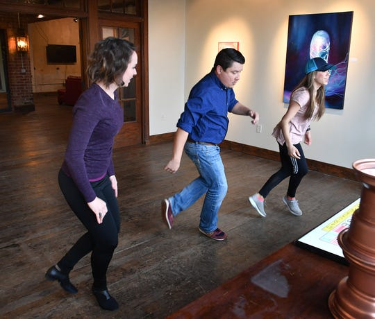Stacie and James Cook practice their footwork during a rehearsal with their instructor, Alicia Ayers, right. The three are competing in Dancing for the Stars Friday which raises money for Big Brothers Big Sisters and the Small Business Development Center at Midwestern State University.