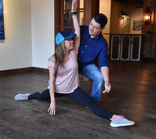 Dance instructor Alicia Ayers and James Cook practice a move as part of a Dancing for the Stars routine that Cook will perform with his wife, Stacie Cook. The event raises money for the Small Business Development Center at Midwestern State University and Big Brothers Big Sisters.