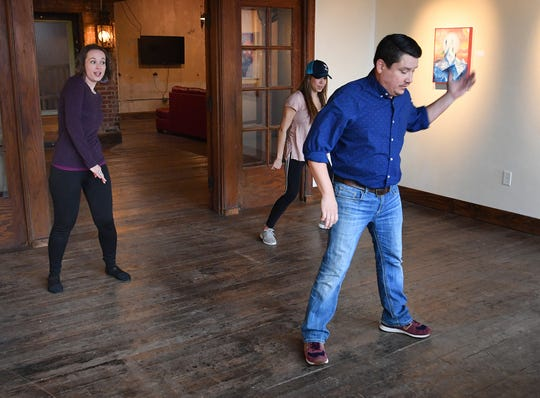 Stacie Cook, left, James Cook and instructor, Alicia Ayers practice their dance moves as they rehearse for Friday night's Dancing for the Stars.