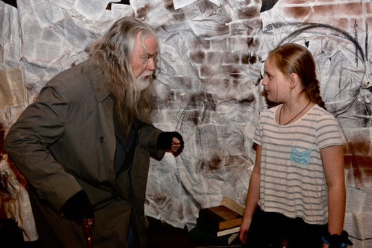 """Oliver (Adalyn Marquardt) confronts Fagin (Bob Barrow) in Backdoor Theatre's new production of """"Oliver!"""" set to open 7:30 p.m. Friday, Feb. 21 and Saturday, Feb. 22 at the Backdoor Theatre. The musical continues Feb. 27 to 29, March 5 to 7, and March 12 to 14."""