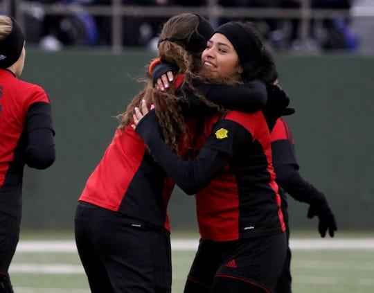 Wichita Falls High's Maria Gonzalez hugs Araceli Ramirez after scoring a goal against Abilene Cooper Tuesday, Feb. 11, 2020, at Memorial Stadium.