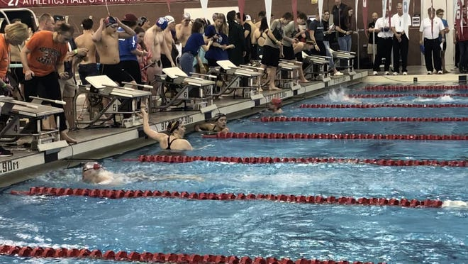 Tri-Valley senior Caroline Holmes wins the Division II district title in the 200 freestyle. Holmes will continue her swimming career at Division II Hillsdale College in Michigan.