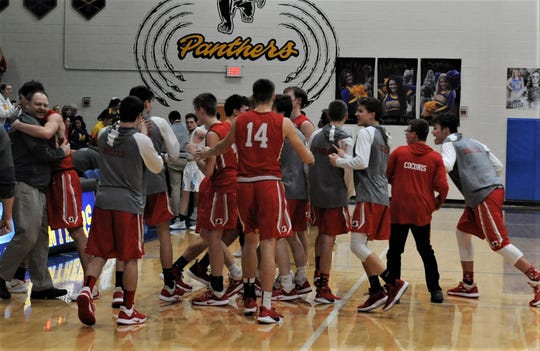 Sheridan celebrates its 71-67 overtime against Maysville on Tuesday, which clinched a share of the Muskingum Valley League title. It's the first league crown for the Generals since they shared with John Glenn in 2010-11.