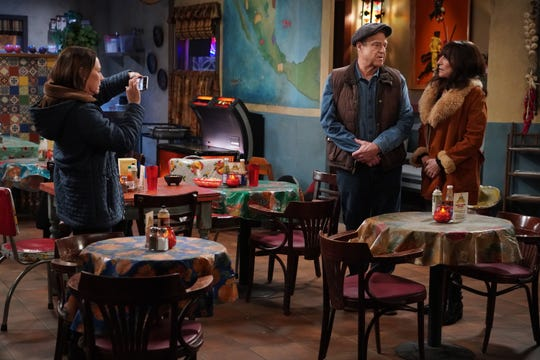 Jackie (Laurie Metcalf), left, takes a picture of Dan (John Goodman) and Louise (Katey Sagal), but family's attempt to unite the couple doesn't go as planned during Tuesday's live broadcast of ABC's 'The Conners.'