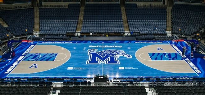 Memphis's FedEx Forum. Their court is covered in blue tiger imagery.