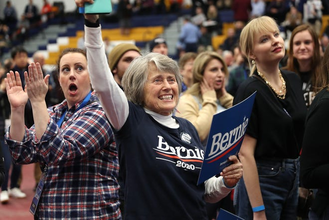 MANCHESTER, NEW HAMPSHIRE - FEBRUARY 11:   Democratic presidential candidate Bernie Sanders' supporters watch early results at Sanders' New Hampshire primary night event on February 11, 2020 in Manchester, New Hampshire. New Hampshire voters cast their ballots today in the first-in-the-nation presidential primary.