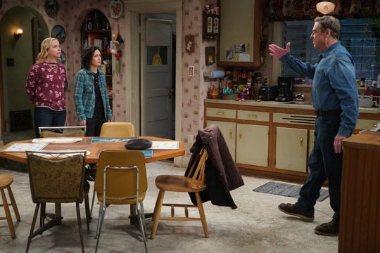 An emotional Dan (John Goodman), right, tells daughters Becky (Lecy Goranson), left, and Darlene (Sara Gilbert) that he's not ready to date because he misses his late wife, Roseanne, during Tuesday's live presentation of ABC's 'The Conners.'