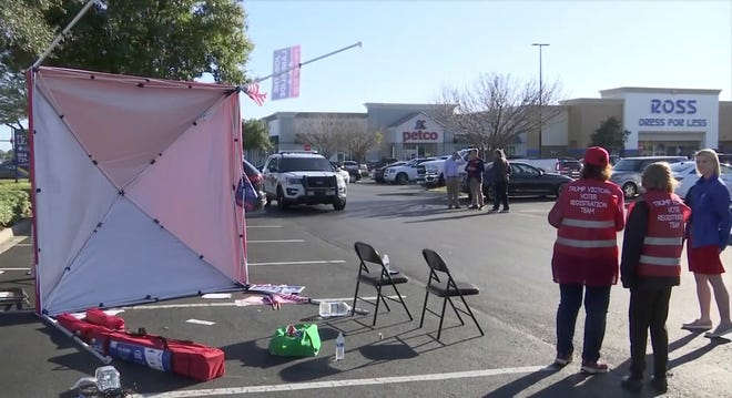 A Republican voter registration tent lays on its side in a shopping center parking lot after a man drove a van through it in Jacksonville, Florida, Feb. 8, 2020.