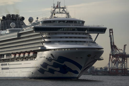 The Diamond Princess arrives back in port in Yokohama, Japan, Feb. 12 after going out to sea to produce potable water. The ship remains under quarantine until Feb. 19 after hundreds of people were diagnosed with coronavirus.