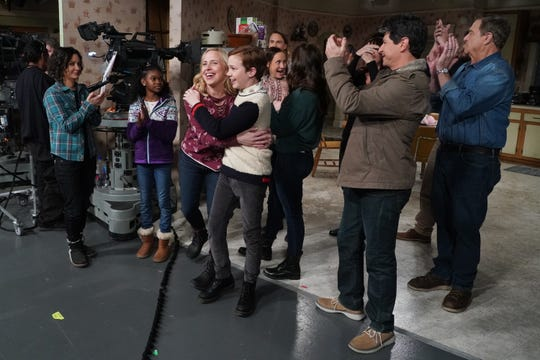 Lecy Goranson and Ames McNamara, center, hug as they and their fellow castmates celebrate after Tuesday's live performance of ABC's 'The Conners.'
