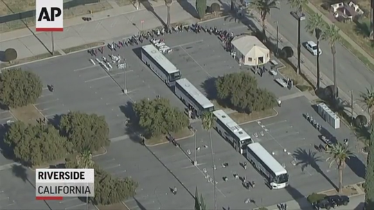 This Associated Press photo shows buses lined up to transport 195 U.S. citizens who tested negative for coronavirus after being quarantined at March Air Reserve Base in Moreno Valley. Lawmakers say they want the federal government to reimburse Riverside County $1.3 million that went toward quarantine efforts.
