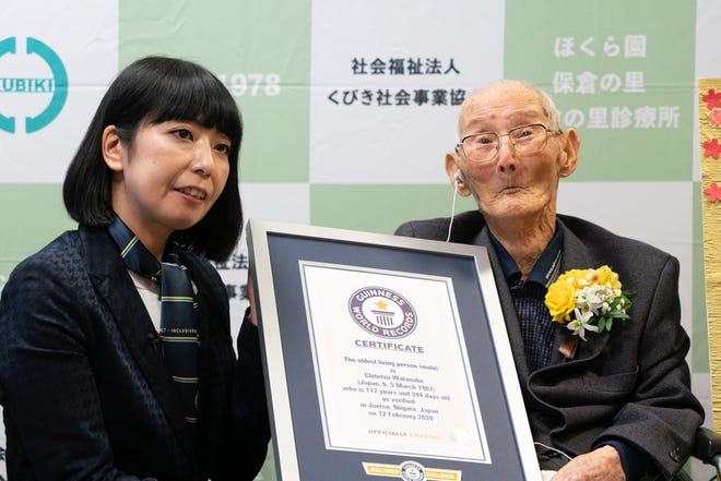 Chitetsu Watanabe is presented with a certificate by Guinness World Records Japan's Country manager Kaoru Ishikawa at the nursing home in his hometown of Niigata, Japan.