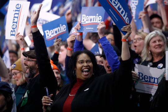 Supporters cheer at a primary night election rally for Democratic presidential candidate Sen. Bernie Sanders, I-Vt., in Manchester, N.H., Tuesday, Feb. 11, 2020. (AP Photo/Matt Rourke) ORG XMIT: NHMR307