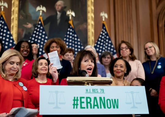 Rep. Jackie Speier, D-Calif., holds up a copy of the Constitution during an event about their resolution to remove the deadline for ratification of the Equal Rights Amendment.