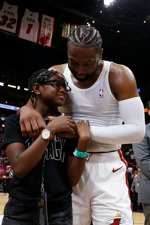 Dwyane Wade hugs Zaya after Wade played in his final game in April.