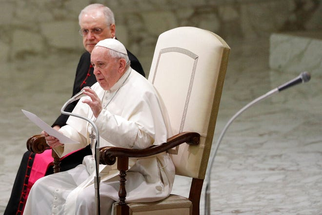 Pope Francis reads his message during the weekly general audience at the Vatican on Wednesday, Feb. 12, 2020.