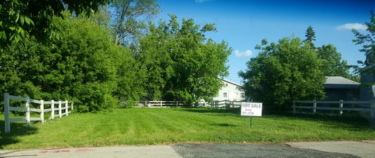 Philip Popour intends to establish a market garden at 410 Walnut St. in Neenah.