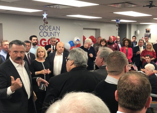 Ocean County Republican Chairman Frank B. Holman III (left) addresses the party faithful who turned out Wednesday night to celebrate the opening of the county GOP's new headquarters in downtown Toms River.