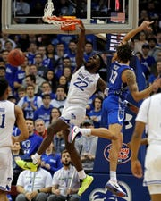 Seton Hall guard Myles Cale (22) slam dunks the ball past Creighton forward Christian Bishop (13) during the first half of an NCAA college basketball game Wednesday, Feb. 12, 2020, in Newark, N.J.. (AP Photo/Adam Hunger)