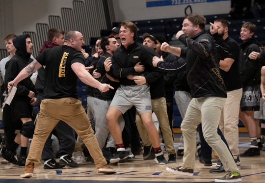 The Southern Regional coaches and wrestlers celebrate of their team's pins Wednesday night in the Rams' 35-26 win over Toms River North in a NJSIAA South Group V semifinal.