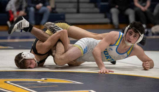 Southern's Nick Bennet (right) is tangled up with Toms River North's Mark Fedeli in the 126-pound bout. Bennet won 11-10 on a takedown at the buzzer.