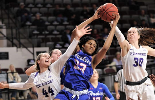 ACU's Lexie Ducat (44) and Anna McLeod (30) fight Houston Baptist's Marilyn Nzoiwu for a rebound in the second half. ACU beat the Huskies 71-54 in the Southland Conference game Wednesday at Moody Coliseum.