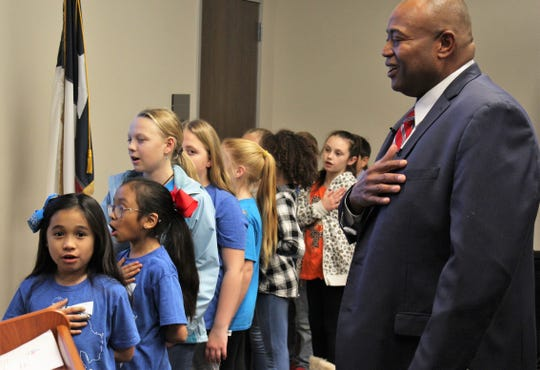 Mayor Anthony Williams joined youngsters from Jackson Elementary School in the Pledge of Allegiance at Monday's State of the City address at the south branch of Abilene Public Library.