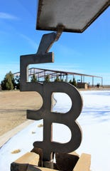 The Boone brand, 5BG, is attached below the family's mailbox. Their new barn is seen under construction in the background.