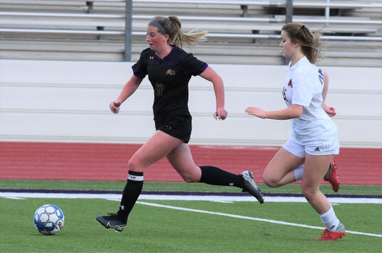 Wylie's Shaelyn Ward (11) gets past an Aledo defender during the District 4-5A opener on Feb. 12. The Lady Bulldogs had one final regular season game before a possible playoff berth when the season was put on hold.