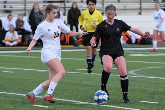Wylie's Shaelyn Ward (11) tries to win the ball against Aledo's Ella Bertram (25) during the District 4-5A opener at Bulldog Stadium on Wednesday. Ward scored for the Lady Bulldogs in the 3-1 loss.