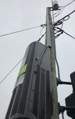 """Verizon has installed a """"small cell"""" tower on a pole at the corner of Hilliard and South French Broad. The equipment expands capacity for online internet services."""