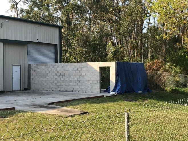 Cocoa-based rocket engine company Rocket Crafters suffered a mishap during its engine test fire Feb. 13, 2020 resulting in flying debris and small brush fires. The blue tarp is covering the damage occurred by the anomaly. No injuries were reported and the company is continuing to investigate the cause.