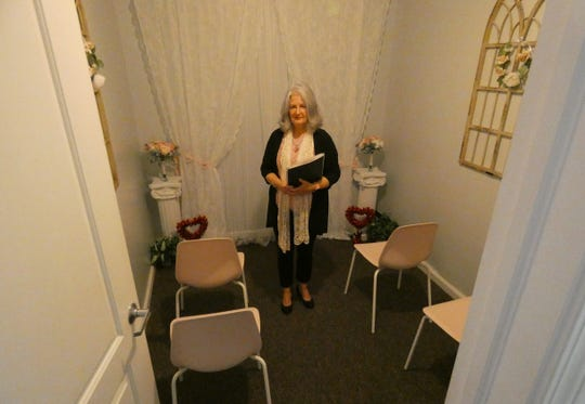 Suzie Massa stands in the chapel at Vintage Vows Wedding Chapel in downtown Crestline.