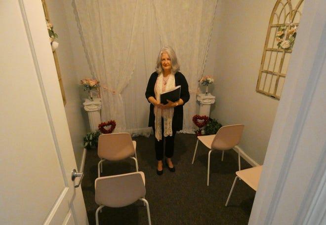 Suzie Massa stands in the chapel at Vintage Vows Wedding Chapel in downtown Crestline.