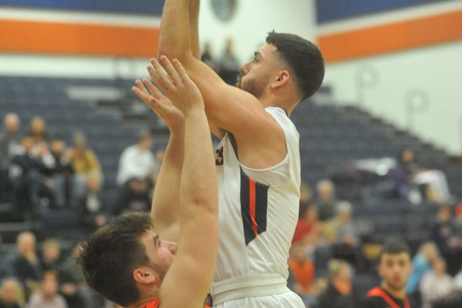Galion's Isaiah Alsip pulls up for a jumper in the paint against Lucas' Ethan Wallace.