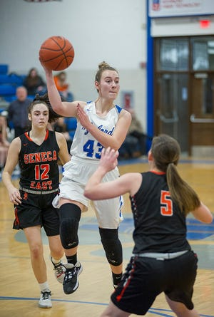Wynford's Lyndie Williams drives into the paint and dishes out to a teammate.