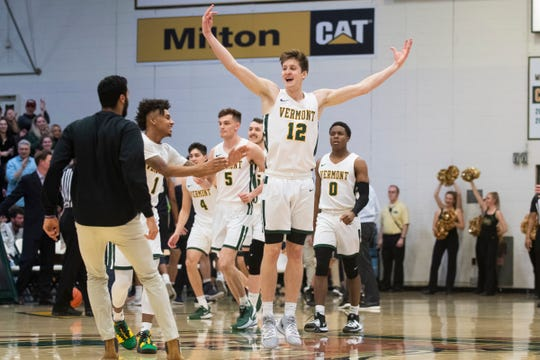 Vermont's Bailey Patella (12) celebrates after dunking the ball during the men's basketball game between the New Hampshire Wildcats and the Vermont Catamounts at Patrick Gym on Wednesday night February 12, 2020 in Burlington, Vermont.