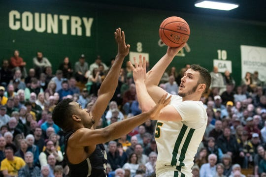 Vermont's Ryan Davis (35) leaps to take a shot during the men's basketball game between the New Hampshire Wildcats and the Vermont Catamounts at Patrick Gym on Wednesday night February 12, 2020 in Burlington, Vermont.