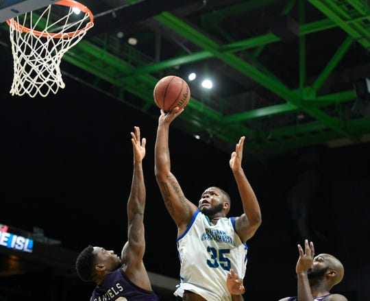 The Islanders' Tony Lewis, center, shoots the ball at the game against Stephen F. Austin, Wednesday, Feb. 12, 2020, at the American Bank Center. Lewis scored six points during the game.